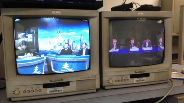 Among other courses, the China Executive Leadership Academy in Shanghai teaches public relations to government officials, including mock TV shows and mock press conferences. NPR's Frank Langfitt took this photo from a control room, because the presence of a foreign reporter in class rattled some of the participants.