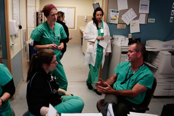Medical staff in the emergency dept. confer at Denver Health, Nov. 2013. The department's director say the unit is seeing an unprecedented number of people landing in the emergency room with injuries or other health problems related to mental illness.