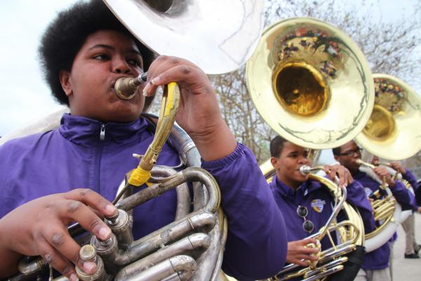 "Nicholas Nooks (left) is known in the band room as ""Big Nick."" At nearly 300 pounds, he seemed like a good fit for football, but he gave up the sport in favor of playing sousaphone and tuba."