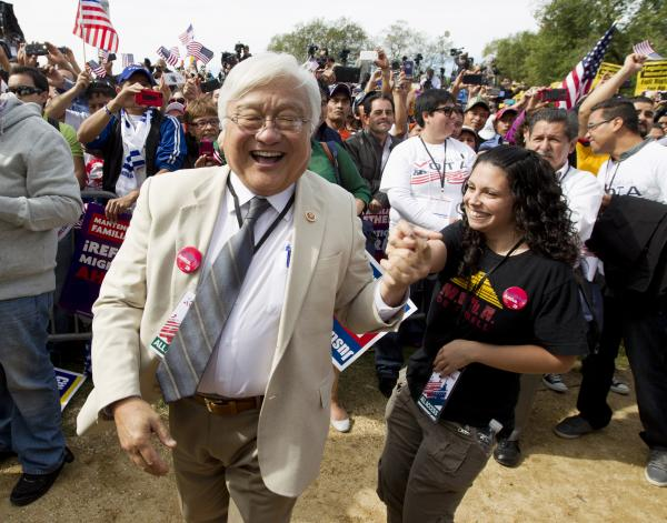 Rep. Mike Honda, D-Calif., dances to the music of Los Tigres del Norte during an immigration rally on the National Mall in Washington in October 2013.