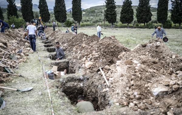People dig graves Thursday for miners who died in an explosion in Soma, Turkey. Anger over what's being called the deadliest industrial accident in the country's history has set off protests nationwide.