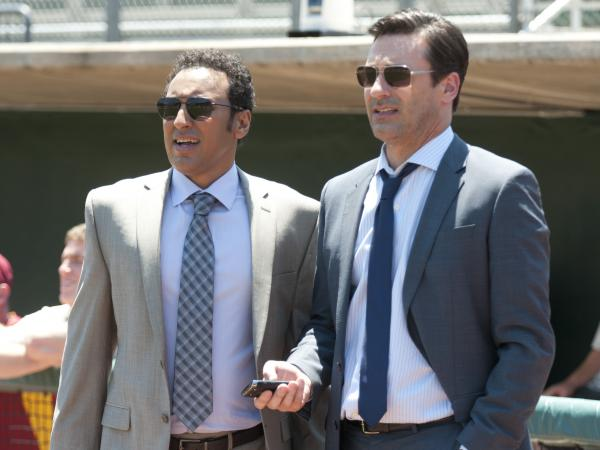 Aasif Mandvi (left) and Jon Hamm check out the talent in <em>Million Dollar Arm</em>.