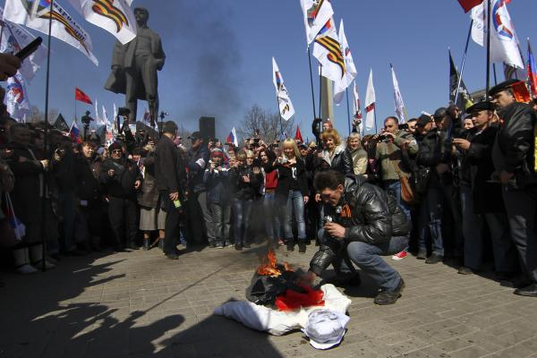 A pro-Russia protester in Ukraine sets on fire an effigy of Stepan Bandera, on April 6 in the eastern city of Donetsk. Though he died more than a half-century ago, Bandera remains a deeply divisive figure in the current crisis in Ukraine.