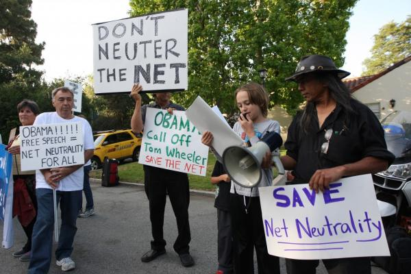 People demonstrate for net neutrality in the neighborhood of Bel-Air outside a USC Shoah Foundation fundraiser to be attended by President Barack Obama on May 7, 2014 in Los Angeles, California. (David McNew/Getty Images)