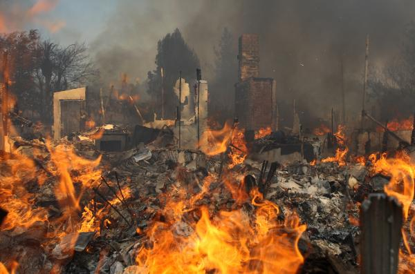 A house burns at the Cocos fire in San Marcos, Calif., Thursday. Fire agencies are girding for what is already proving to be a dangerous year of wildfires, as California suffers an extreme drought.