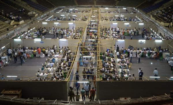 Indian election officials, polling agents and observers gather as electronic voting machines are examined in Kolkata on May 16.