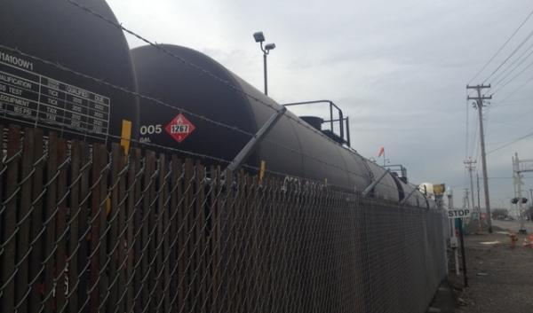 Tank cars of crude oil line the fence at Arc Terminals in NW Portland. Shipments of Utah  crude are destined for the terminal, according to state rail officials.