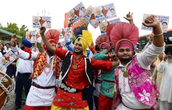 Indian artists dance as they wait for the arrival of the chief minister of the western Indian state of Gujarat and Bharatiya Janata Party prime-ministerial candidate Narendra Modi in New Delhi on Saturday.