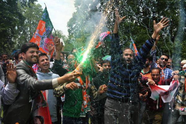 Bharatiya Janata Party supporters set off firecrackers and dance to celebrate Modi's victory in India's general elections in Srinagar, India, on Saturday.