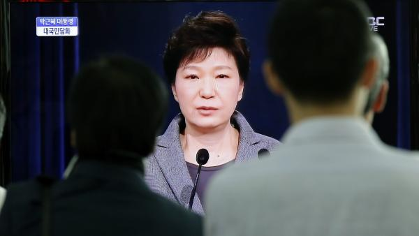 People watch a live speech by South Korean President Park Geun-hye, who said she is disbanding the coast guard over its handling of the Sewol ferry disaster.