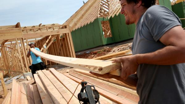 Max Alvarez (left) and Hollan Corliss construct a new home in Moore, Okla., to replace one that was destroyed in May 2013. More than 300 new homes have been built since the tornado, in addition to the 1,100 that are being rebuilt.