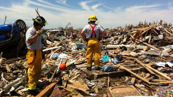 After a tornado leveled Moore, Okla., last year, firefighter Shonn Neidel (left) developed an app that helps first responders locate storm shelters under the wreckage.
