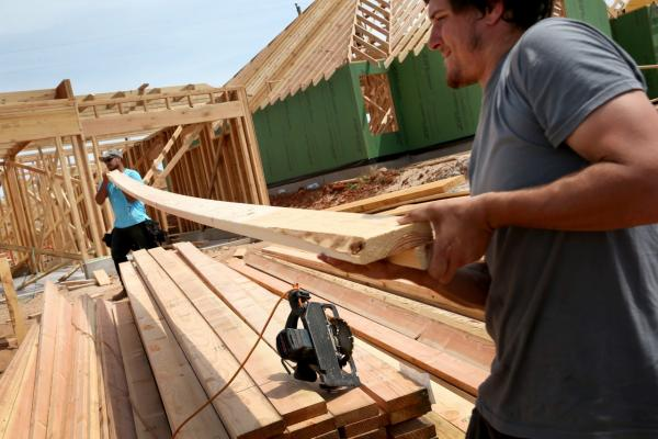 Max Alvarez (left) and Hollan Corliss work on building a new home to replace the one that was destroyed almost one year ago by a tornado on May 19, 2014 in Moore, Oklahoma. (Joe Raedle/Getty Images)