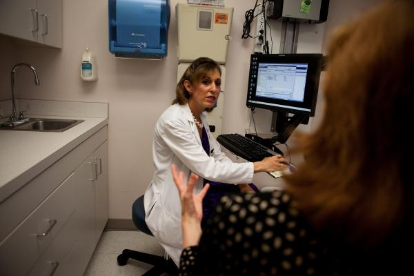 Dr. Andrea Singer, an internist at Georgetown University's hospital, discusses the HPV test with her patient, Robin Reath.