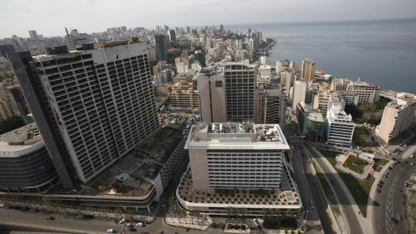 An aerial view shows the war-ravaged and deserted former Holiday Inn hotel (the tall building on the left), next to the Phoenicia hotel in 2011.
