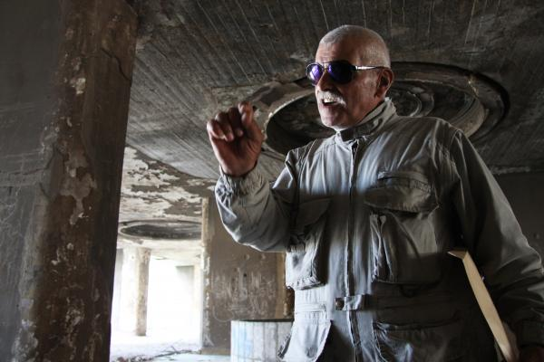 Abu Darwish was a fighter who took part in battles at the Beirut Holiday Inn during the Lebanese civil war in the 1970s and '80s. The building's battered shell remains, but it has not yet been decided whether to tear it down or renovate it.