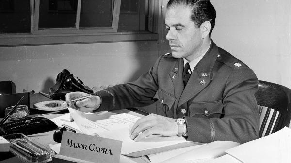 Maj. Frank Capra sits at his War Department desk in Washington on March 6, 1942. Capra's non-War Department films include <em>It's A Wonderful Life</em> and <em>Mr. Smith Goes To Washington</em>.