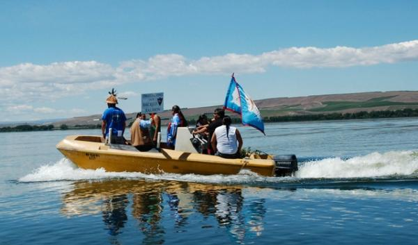 Yakama Nation fishers and tribal leaders hopped on boats to the fishing site. As a protest, they dropped a net right next to the proposed Morrow Pacific coal export facility.