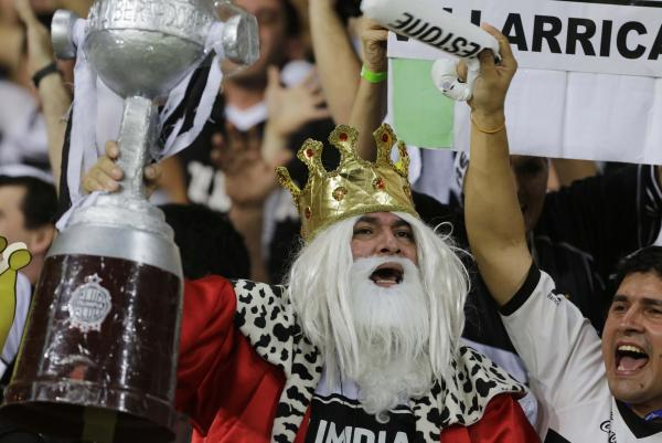 The kings of positive feelings: Paraguay's citizens were found to have the most positive things to say about their lives, according to a recent poll. Here, soccer fans cheer for Paraguay's Olimpia team last year.