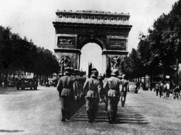 German troops march towards Paris' Arc de Triomphe in 1943.