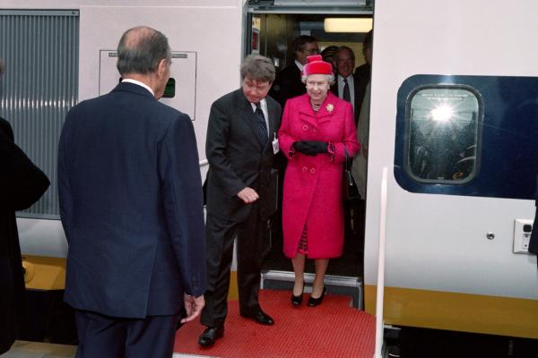 French President François Mitterrand welcomes Queen Elizabeth II during the inauguration of the Channel Tunnel, on May 6, 1994, in Coquelles. (Jacques Demarthon/AFP/Getty Images)