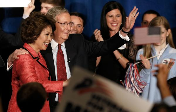 Senate Republican Leader Sen. Mitch McConnell (R-KY) and his wife Elaine Chao wave to supporters after a celebration following his victory over Tea Party candidate Matt Bevin in the state Republican primary on May 20 in Louisville. (Win McNamee/Getty Images)