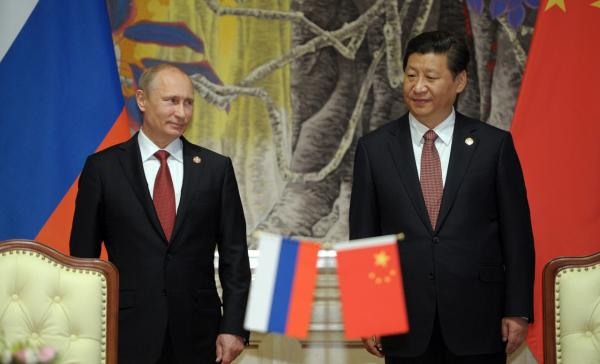 Chinese President Xi Jinping and Russian President Vladimir Putin attend an agreement signing ceremony in Shanghai today. China and Russia signed today a monumental, multi-decade gas supply contract in Shanghai, Chinese state energy giant CNPC said, with reports saying it could be worth as much as $400 billion. (Alexey Druzhinin/AFP/Getty Images)
