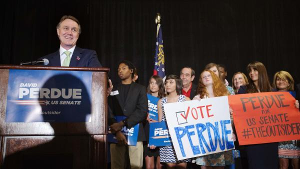 Georgia Republican Senate candidate David Perdue (left) speaks to supporters at a primary election night party on Tuesday in Atlanta.