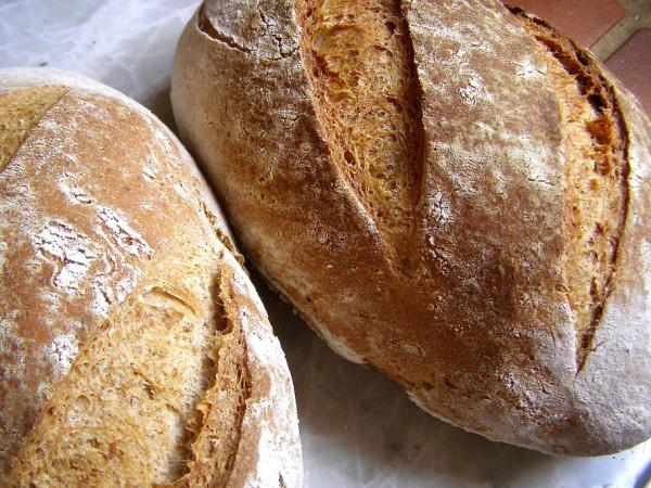 The wheat and grains in many breads contain gluten.