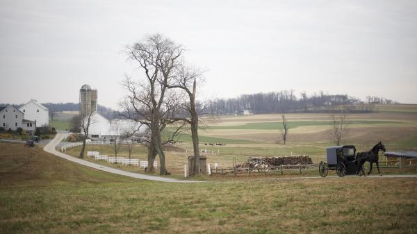 The tourism attracted by the Amish population in Lancaster, Pa., is now making it harder for Amish to maintain their traditional lifestyle. Some families are leaving the area as a result.