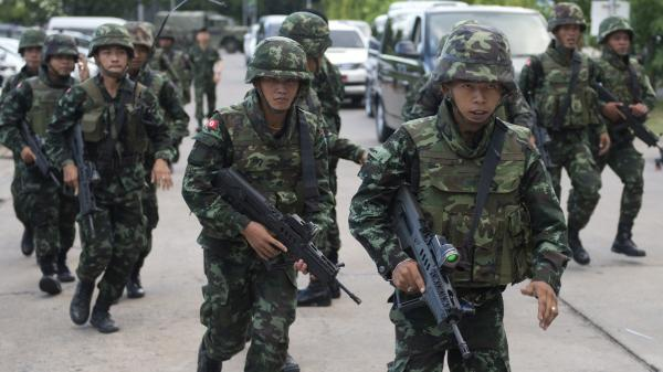 Thai soldiers patrol after army chief Gen. Prayuth Chan-ocha announced that the armed forces were seizing power after months of political turmoil.