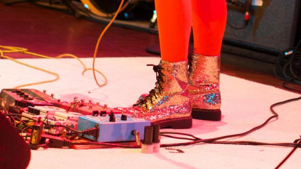 To what musician do these sparkly boots belong?