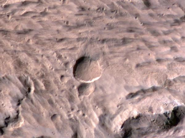 A photograph of the new crater (large, center). Take by the Mars Reconnaissance Orbiter's High Resolution Imaging Science Experiment.