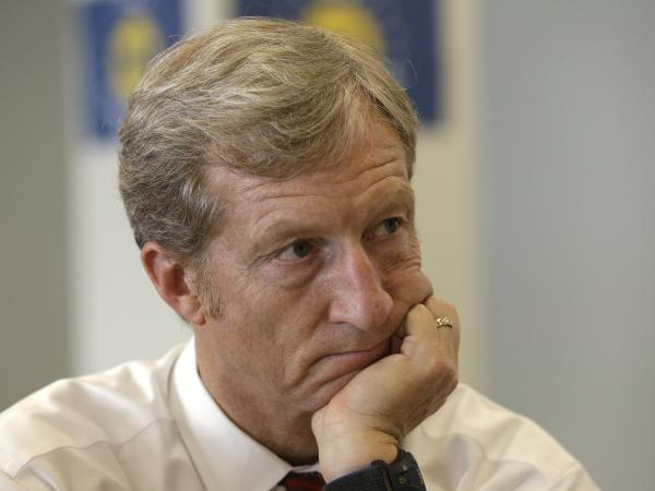 Businessman Tom Steyer listens during a meeting to announce the launch of a group called Virginians for Clean Government in September 2013.
