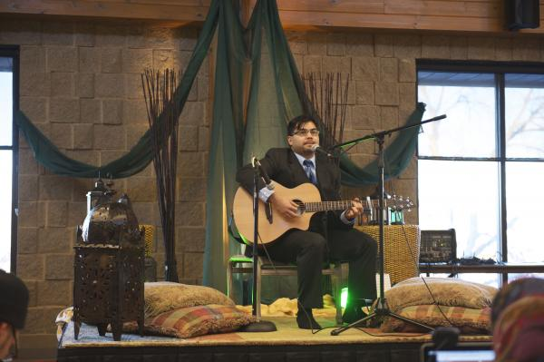 "Zain Lodhia plays an original song at a Mawlid, a birthday celebration for the Prophet Muhammad. The event was sponsored by the Webb Foundation, a so-called ""Third Space"" Muslim faith community outside the traditional mosque."