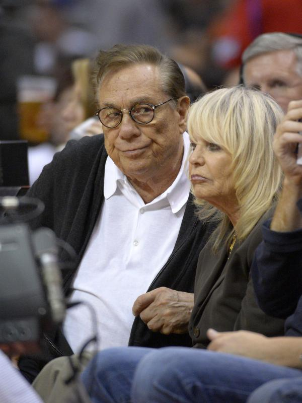 Los Angeles Clippers owner Donald Sterling has reportedly agreed to sell the team, allowing his wife, Shelly, to broker a deal. They're seen here at a 2012 game.