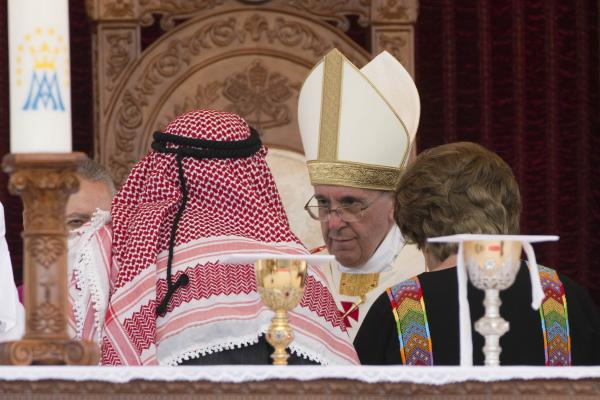 Pope Francis is greeted by King Abdullah II of Jordan and his wife Queen Rania, as they meet in Amman's Al Husseini Royal Palace in Jordan on Saturday.