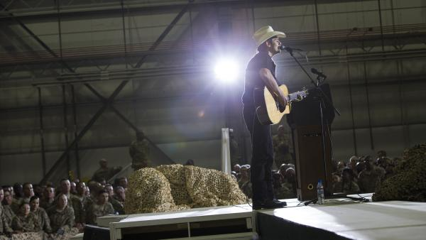Country music singer Brad Paisley performs during a troop rally with President Obama during an unannounced visit at Bagram Air Field on Sunday.