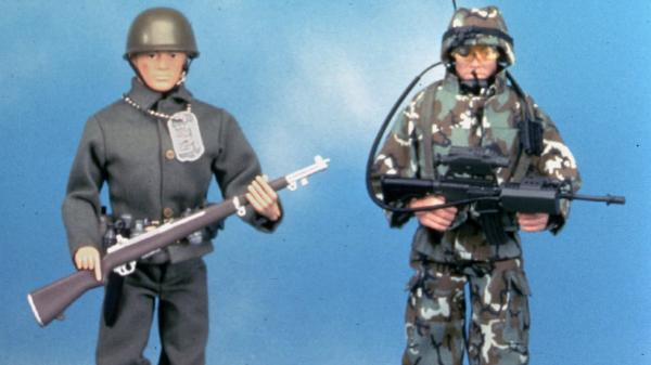 At left is a reproduction of the original G.I. Joe action figure made in 1964. The doll on the right is a newer G.I. Joe model. Hasbro executive Donald Levine, who oversaw the action figure's creation, died last week of cancer.