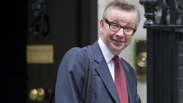 Britain's Education Secretary Michael Gove, seen here in 2013, has been forced to respond to critics of his plan to pull classic American novels from a major British standardized test.