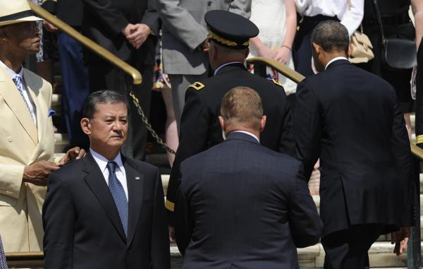 President Obama walks past Veterans Affairs Secretary Eric Shinseki (second from left) after laying a wreath at the Tomb of the Unknown Soldier at Arlington National Cemetery on Monday.