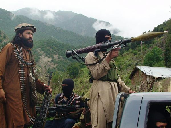 Pakistani Taliban patrol in their stronghold of Shawal in the Pakistani tribal region of South Waziristan, in 2012. The organization has reportedly split over disagreements about tactics.