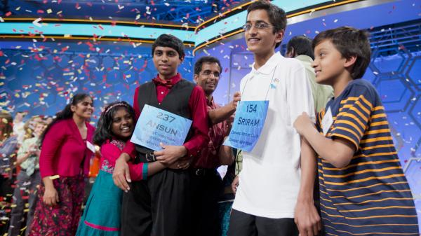 Ansun Sujoe, of Fort Worth, Texas, and Sriram Hathwar, of Painted Post, N.Y., were named co-champions of the 2014 Scripps National Spelling Bee on Thursday. Their siblings helped them celebrate the first shared title since 1962.