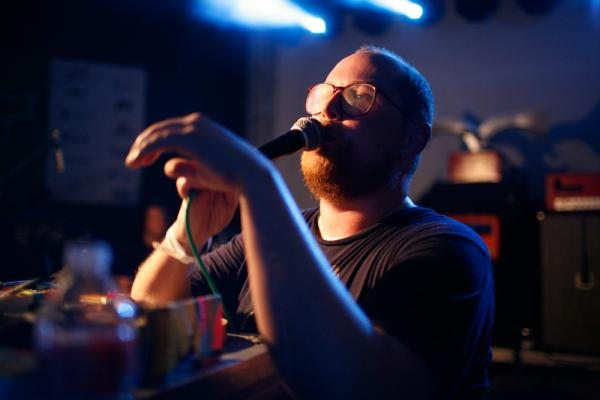 Backed by two drummers, electronic pop artist Dan Deacon needed only a table full of electronics and a ringleader's personality to launch a wild dance party at NPR Music's SXSW Showcase.