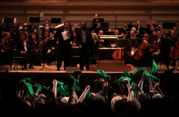 "Fans wave green handkerchiefs to show support for the Oregon Symphony at the ""Spring for Music"" festival at Carnegie Hall on May 12."