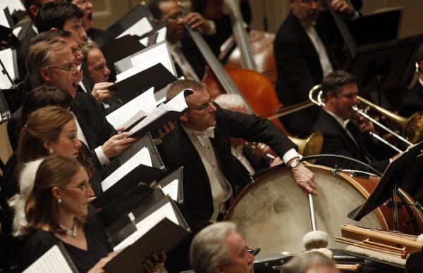 "Members of the Dallas Symphony Orchestra and Chorus perform Steven Stucky's dramatic oratorio ""August 4, 1964"" at the Spring for Music festival at Carnegie Hall May 11, 2011."