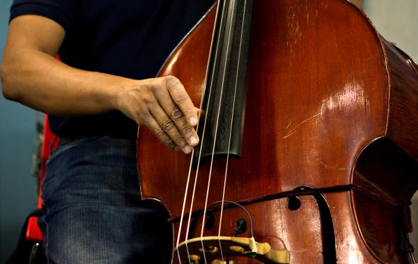Stanley Clarke is known primarily as an electric bassist, but picked up an upright bass for this session.
