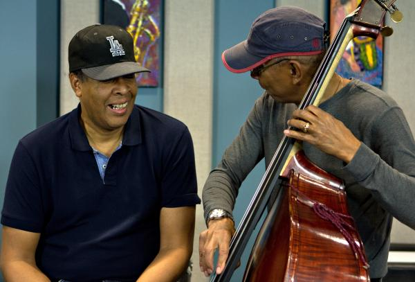 "Jack DeJohnette messes around with Stanley Clarke's bass after performing Victor Feldman's ""Joshua."""