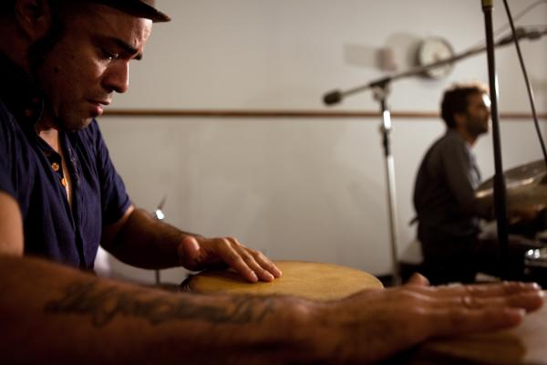 Percussionist Gilmar Gomes concentrates on the congas.