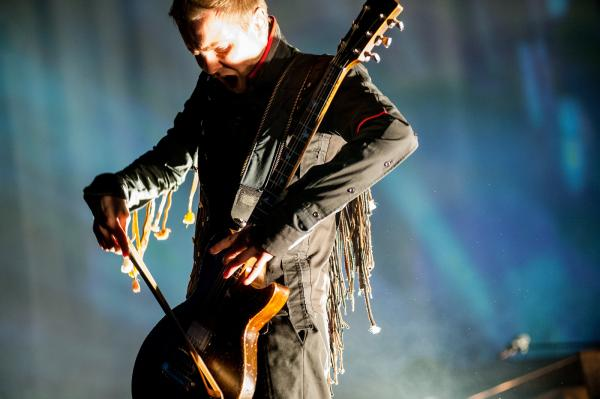 "Lead singer Jonsi plays his signature bowed electric guitar. At the explosive end of ""Hafsol,"" Birgisson frantically ripped hair from the bow."